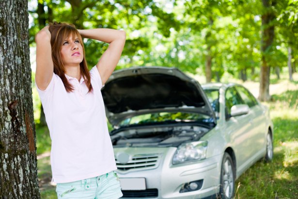 Girl Feeling Stressed When Car Broke Down In A Jungle