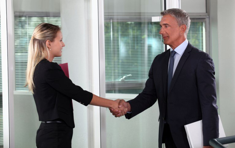 A firm Handshake And A Dress For Success Example - New Employee Meeting The Boss For The First Time