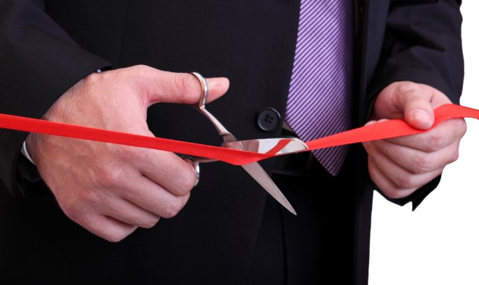 Starting Business Online-Businessman-Cutting-Ribbon
